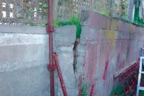 tilting of a concrete retaining wall