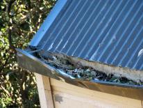 damaged metal gutter