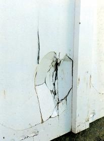 impact damage caused by car or ball