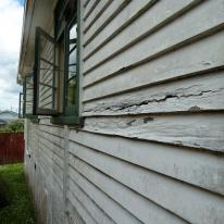 rotted timber weatherboards